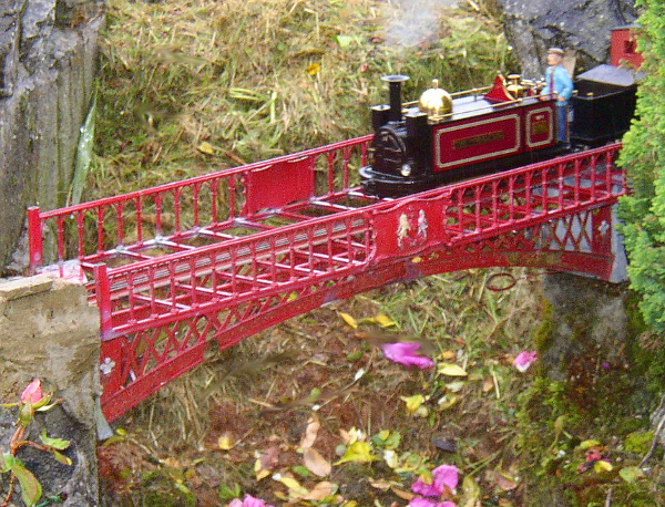 Brass Bridge and visiting loco on one of the annual Open Days. Colin Binnie`s garden railway in Somerset